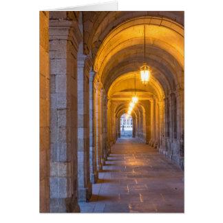 Lamp lit stone hallway, spain card
