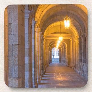 Lamp lit stone hallway, spain coaster