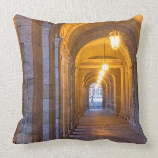 Lamp lit stone hallway, spain cushion