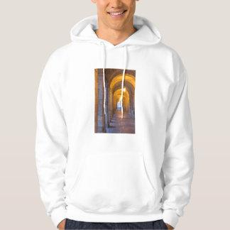 Lamp lit stone hallway, spain hoodie