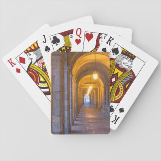 Lamp lit stone hallway, spain playing cards