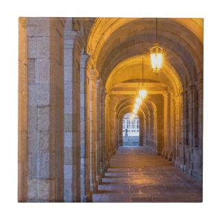 Lamp lit stone hallway, spain tile