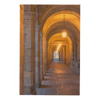 Lamp lit stone hallway, spain wood wall art