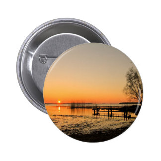 Landing stage on a lake with sunset pin