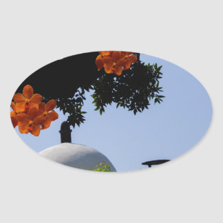 Landscape with orange orchids oval sticker