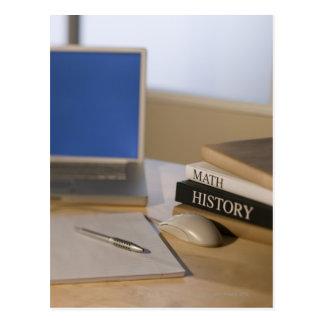 Laptop computer and textbooks postcard