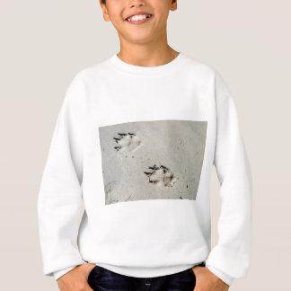 Large dog's paw prints on wet sand sweatshirt