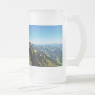 Large glass cup of alps with upper baptism in the frosted glass mug