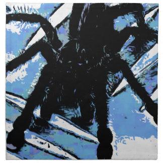 Large spider on metal surface napkin