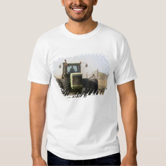 Large tractor cultivating spring soil on a t-shirts