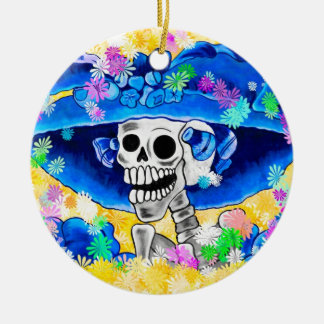 Laughing Skeleton Woman in Blue Bonnet on Yellow Ceramic Ornament