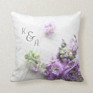 Lavender-colored flowers on old music throw pillow