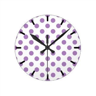 Lavender polka dots on white round clock