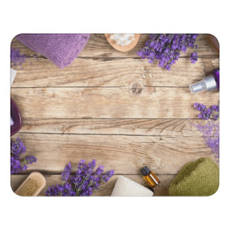 Lavender Wellness Products On Wooden Table Door Sign