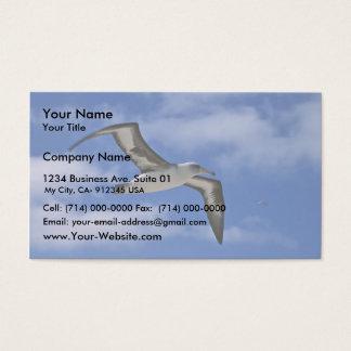 Laysan albatross flying in air business card