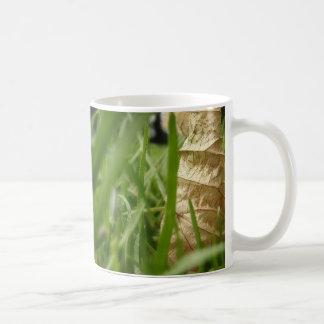 Leaf in grass coffee mug