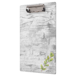 Leaf on light grey woodgrain clipboard