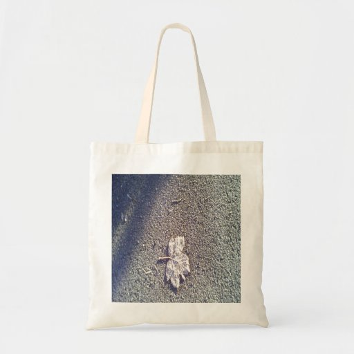 Leaf on the road tote bags