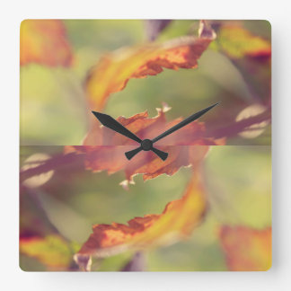 Leaves in the wind square wall clock