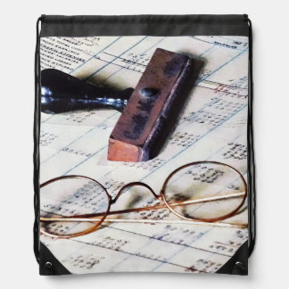 Ledger With Eyeglasses and Rubber Stamp Drawstring Bag