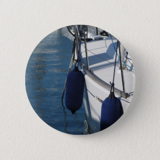 Left side of sailing boat with two blue fenders 6 cm round badge