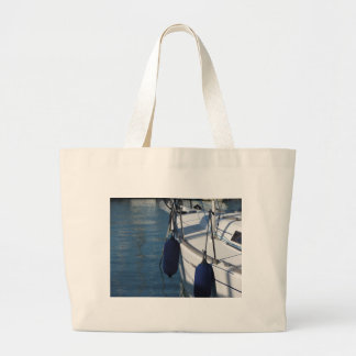 Left side of sailing boat with two blue fenders large tote bag