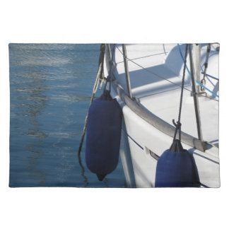 Left side of sailing boat with two blue fenders place mats
