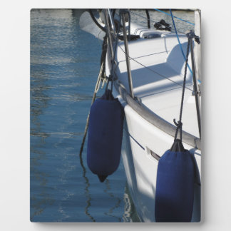 Left side of sailing boat with two blue fenders plaques