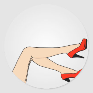 Legs of a woman wearing red stilettos classic round sticker