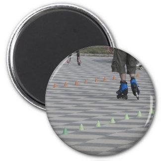 Legs of guy on inline skates . Inline skaters 6 Cm Round Magnet