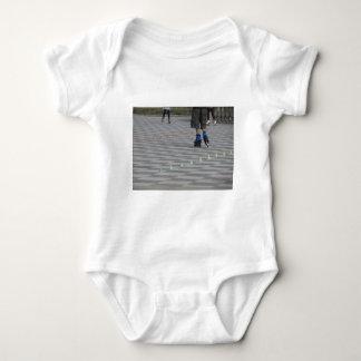 Legs of guy on inline skates . Inline skaters Baby Bodysuit