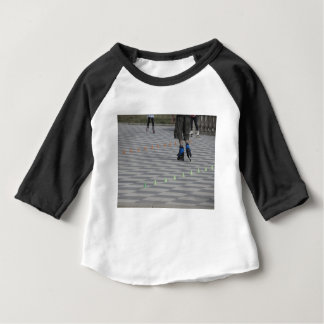 Legs of guy on inline skates . Inline skaters Baby T-Shirt