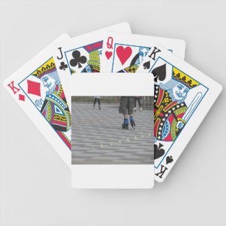Legs of guy on inline skates . Inline skaters Bicycle Playing Cards