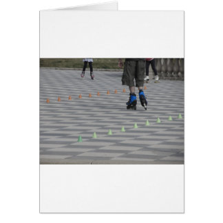 Legs of guy on inline skates . Inline skaters Card