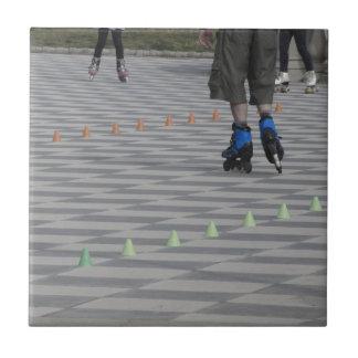Legs of guy on inline skates . Inline skaters Ceramic Tile