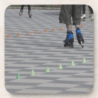 Legs of guy on inline skates . Inline skaters Drink Coasters