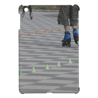 Legs of guy on inline skates . Inline skaters iPad Mini Covers