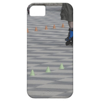Legs of guy on inline skates . Inline skaters iPhone 5 Case