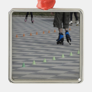 Legs of guy on inline skates . Inline skaters Metal Ornament