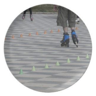 Legs of guy on inline skates . Inline skaters Party Plates