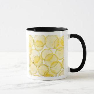 Lemon slices arranged in pattern backlit mug
