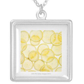 Lemon slices arranged in pattern backlit square pendant necklace