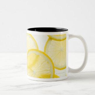Lemon slices arranged in pattern backlit Two-Tone coffee mug