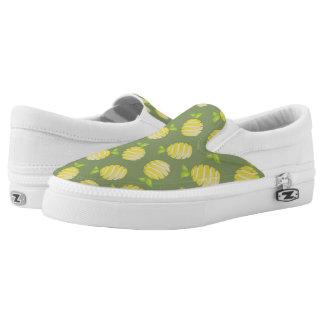 Lemons on green slip on shoes