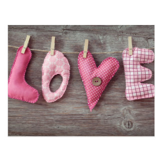 Letters Love on Wooden Table Postcard