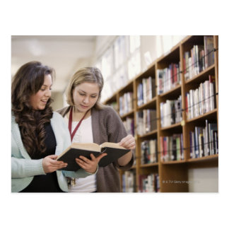 Librarian helping student with research in postcard