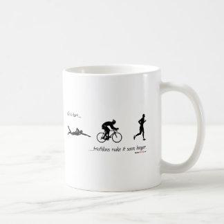 Life is short...triathlons make it seem longer. basic white mug