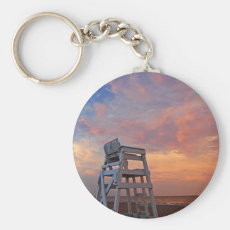 Lifeguard chair with dramatic sky. key ring