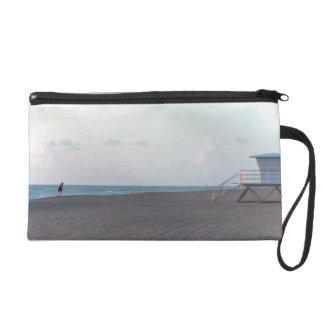 lifeguard shack on beach with walker wristlet purses