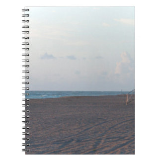 lifeguard shack on beach with walker spiral notebooks